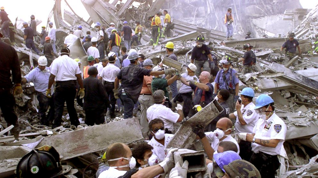rescue-workers-remove-rubble-at-the-world-trade-center-after-it-was-struck-by-a-commercial-airliner-in-a-terrorist-attack